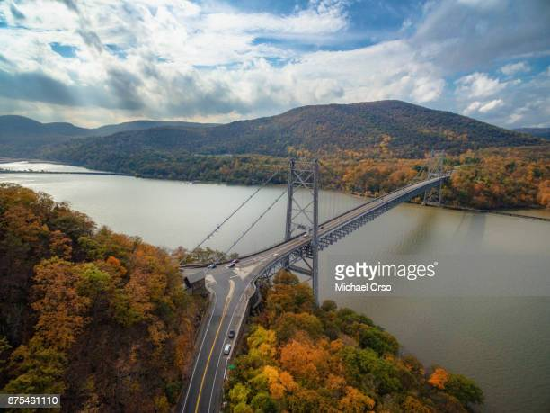 aerial image of bear mountain bridge during peak fall foliage - westchester county stock pictures, royalty-free photos & images