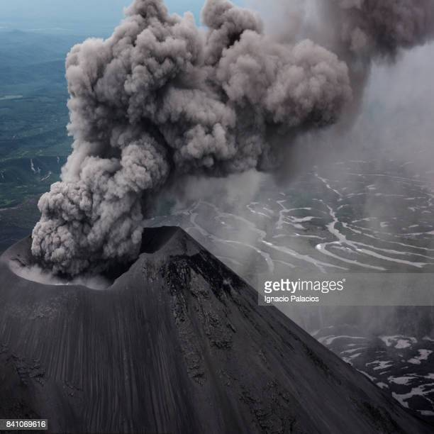 aerial image of karymsky volcano from an mi8 helicopter. karymsky is an active stratovolcano and one of the most active volcano on the peninsula. - volcanic landscape stock pictures, royalty-free photos & images