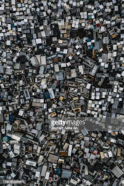 aerial image showing a large pile of discarded appliances, england, united kingdom - consumerism stock pictures, royalty-free photos & images