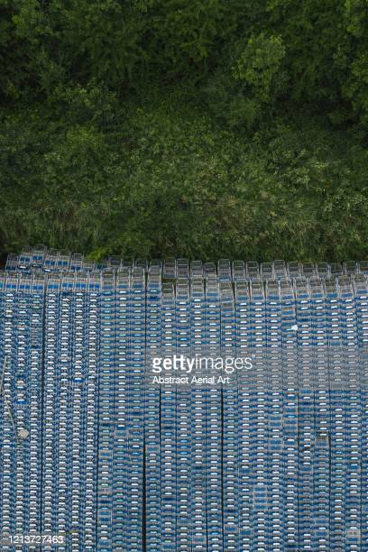 aerial image showing old shopping carts next to a tree area, united kingdom - climate change stock pictures, royalty-free photos & images