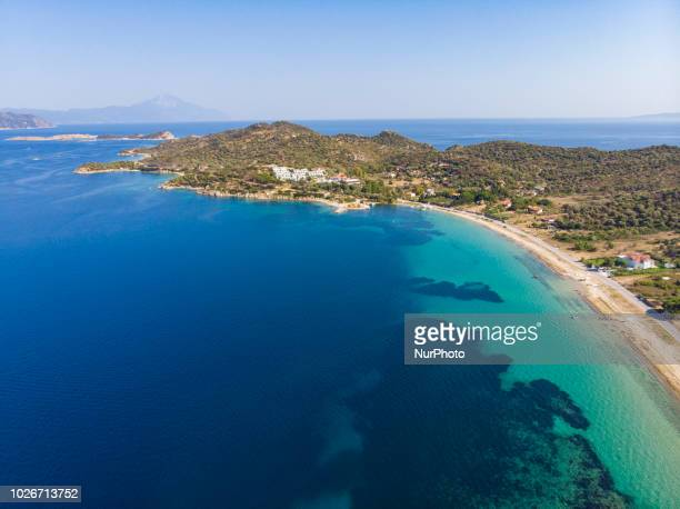 Aerial images of Ammouliani or Amouliani or Amoliani island in Greece. Ammouliani is a little island located in Chalkidiki region in northern Greece....