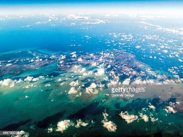 Aerial jet window view turquoise Caribbean sea