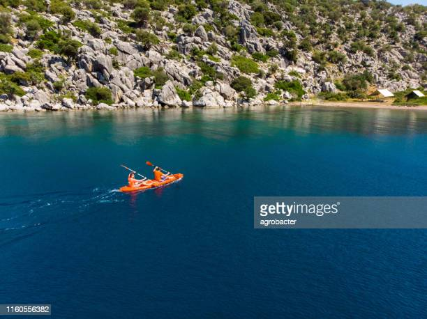 aerial kayak boat canoe on the water sea surface aerial - kayak stock pictures, royalty-free photos & images