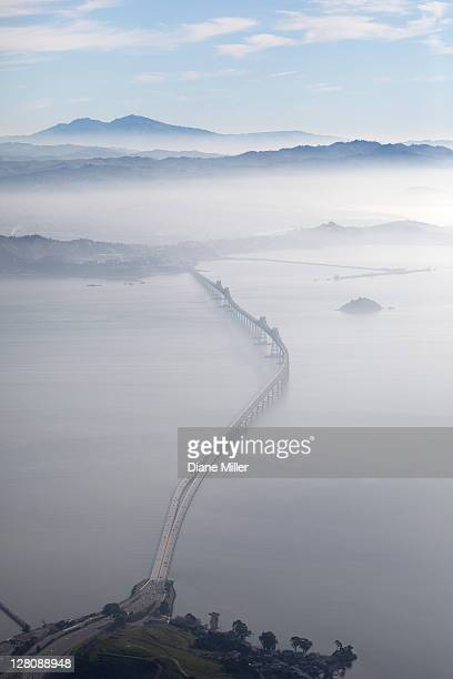 aerial landscape of richmond-san rafael bridge, looking east with clearing morning fog and mt. diablo in background, san francasco bay, california, usa - richmond san rafael bridge stock pictures, royalty-free photos & images
