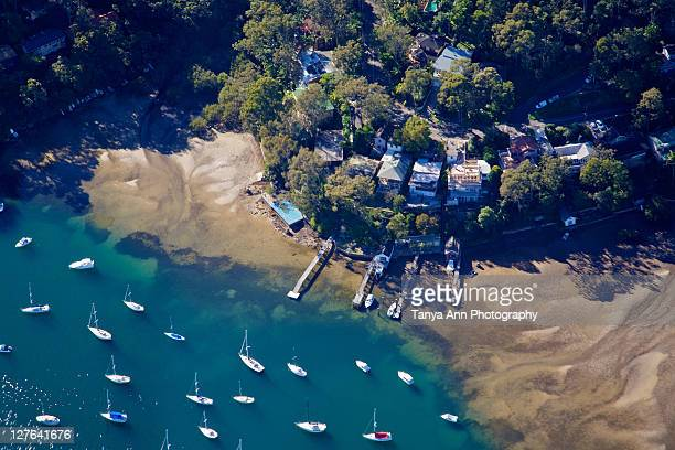 Aerial landscape over boats sand and houses