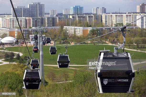 Aerial lifts operate over the IGA International Garden Exhibition on April 13 2017 in Berlin Germany The showcase of flora and horticultural design...
