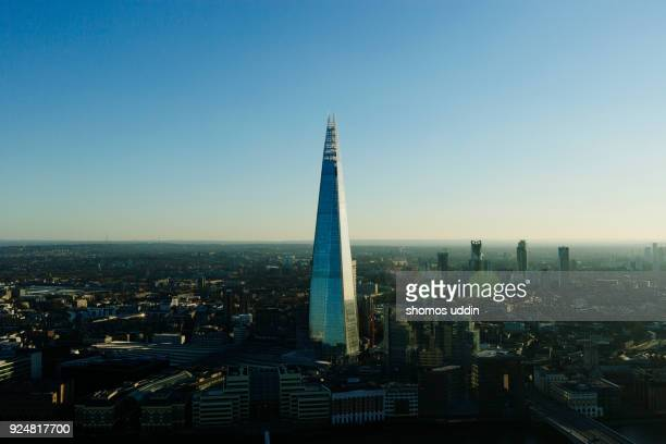 Aerial London cityscape against clear blue sky