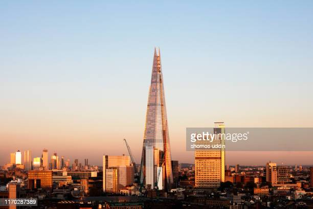 aerial london cityscape at sunset - london docklands stock pictures, royalty-free photos & images