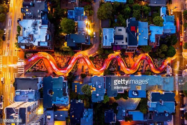 aerial long exposure lombard street traffic san francisco - lombard street san francisco stock pictures, royalty-free photos & images