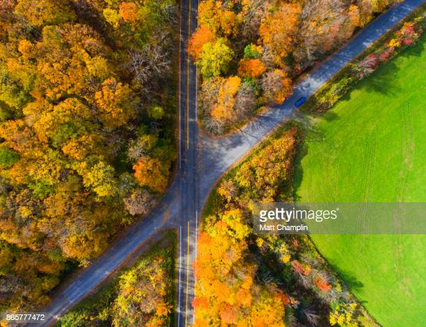 Aerial looking down on Country roads Intersecting on fields and farms