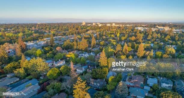 aerial: menlo park suburbs in silicon valley at sunset - silicon valley stock pictures, royalty-free photos & images
