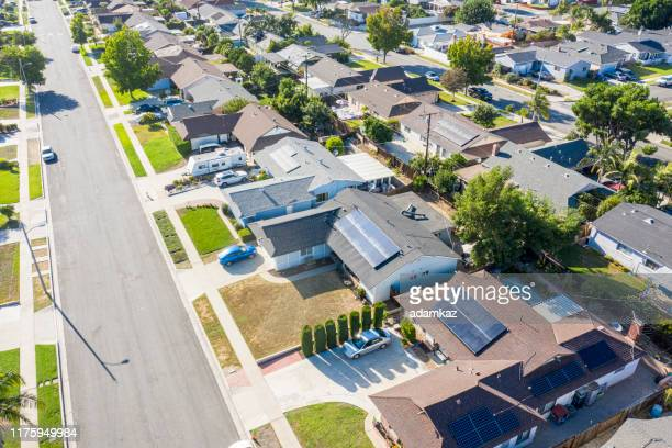 aerial neighborhood with solar panels - residential district stock pictures, royalty-free photos & images