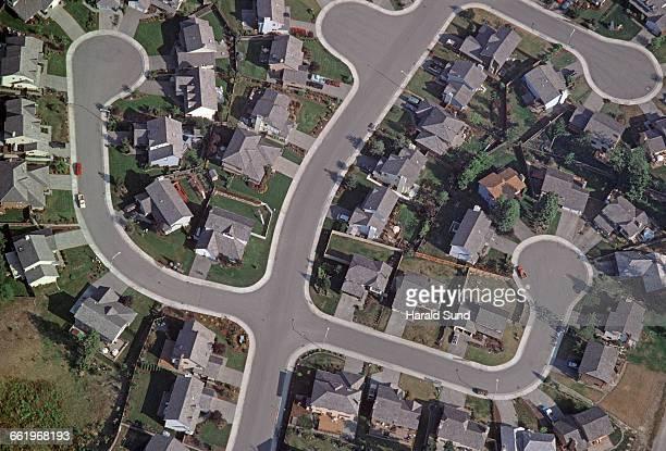 Aerial, new suburb cul-de-sac neighborhood homes.