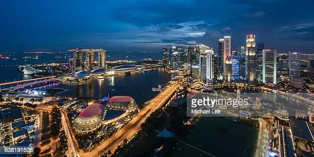 aerial night view of singapore - marina bay singapur stock-fotos und bilder