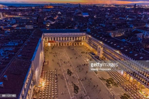 aerial night view of st. mark´s square at venice, italy. - basilica di san marco foto e immagini stock