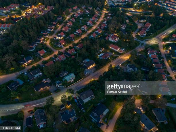 aerial night view over a small city - illuminated stock pictures, royalty-free photos & images