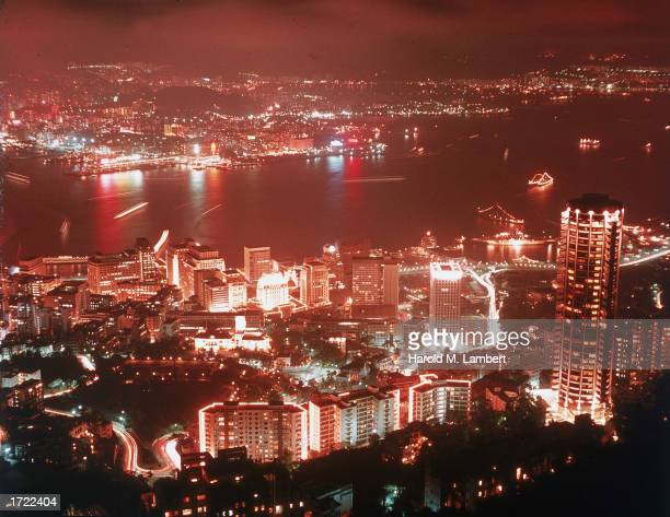 Aerial nighttime view of Hong Kong with boats in the harbor 1970s