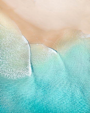 Aerial of a beach with beautiful waves, white sand and ocean textures 1161051898