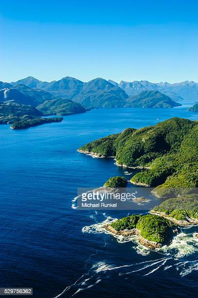 aerial of a huge fjord in fiordland national park, unesco world heritage site, south island, new zealand, pacific - international landmark stock pictures, royalty-free photos & images