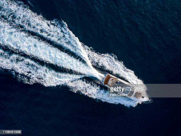 aerial of a luxury motor yacht - stereotypically upper class stock pictures, royalty-free photos & images