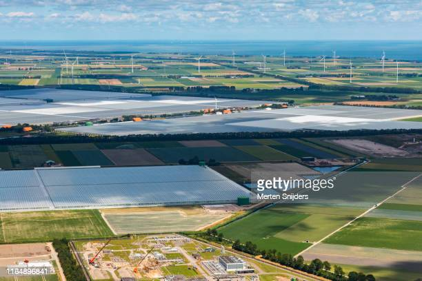 aerial of agriport with greenhouse horticulture complex - merten snijders stock pictures, royalty-free photos & images