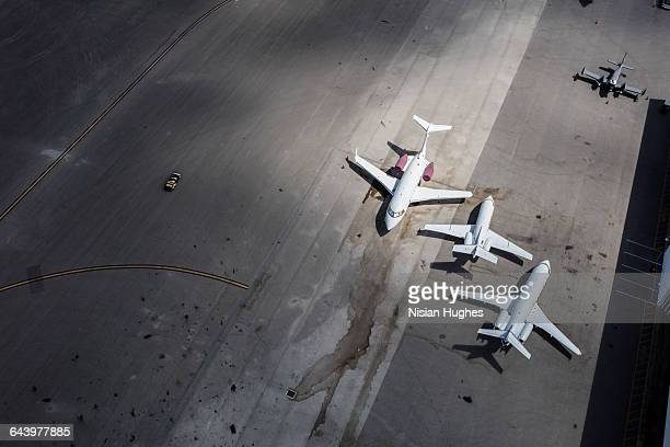 Aerial of airplanes parked at airport