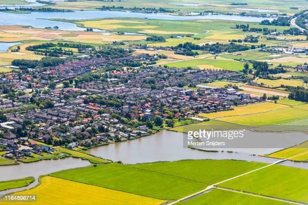 aerial of akersloot town along alkmaardermeer - merten snijders stock pictures, royalty-free photos & images