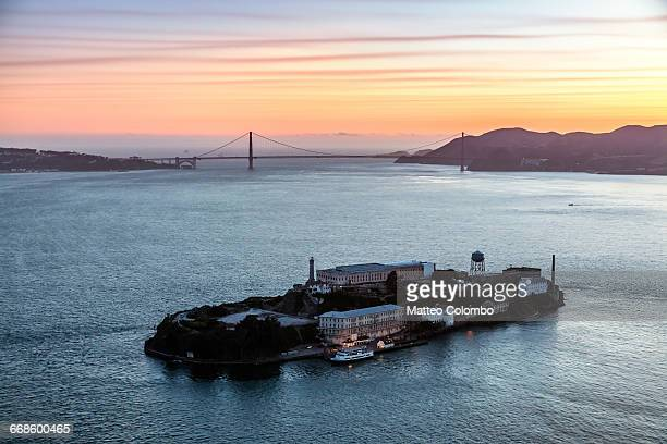 aerial of alcatraz at sunset, san francisco, usa - alcatraz stock photos and pictures