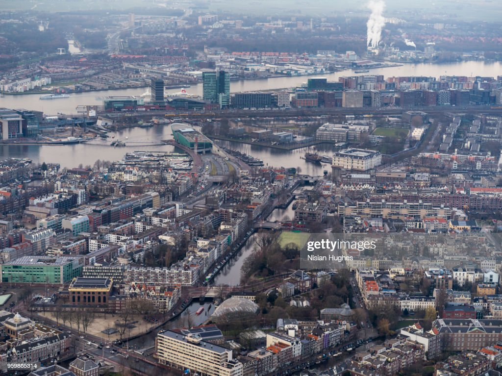 Aerial of Amsterdam city center with rooftops and canals : Stock Photo
