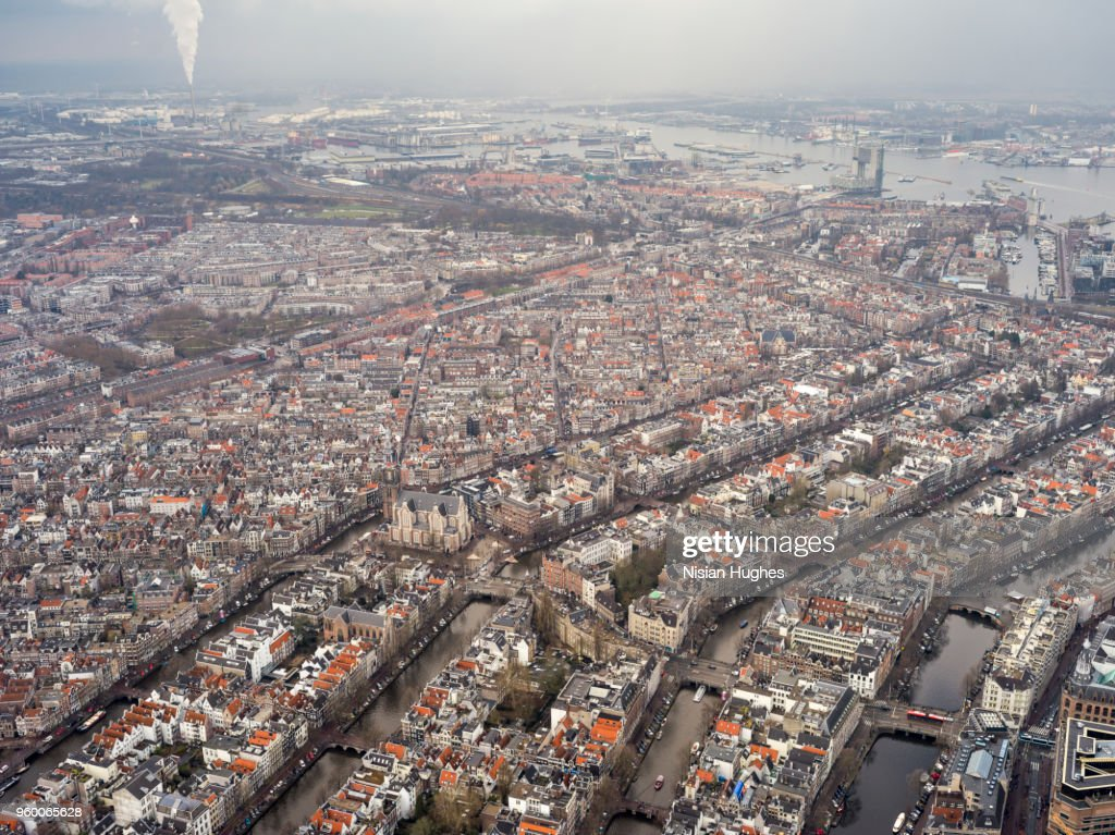 Aerial of Amsterdam city center with rooftops and canals : Stock-Foto