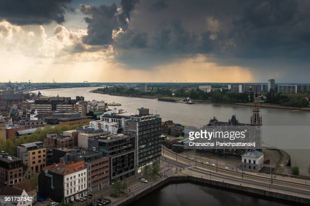 aerial of antwerp city along scheldt river - antwerpen stad stockfoto's en -beelden