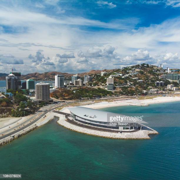 aerial of apec house in port moresby - port moresby stock pictures, royalty-free photos & images