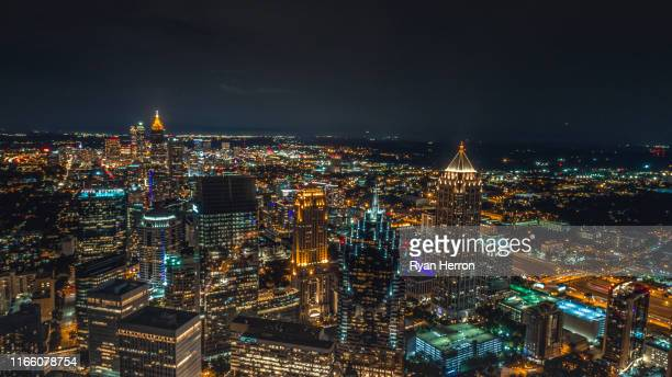 aerial of atlanta at night - atlanta skyline stock pictures, royalty-free photos & images