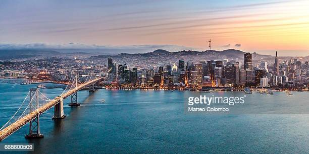 aerial of bay bridge and downtown, san francisco - bay bridge stock pictures, royalty-free photos & images