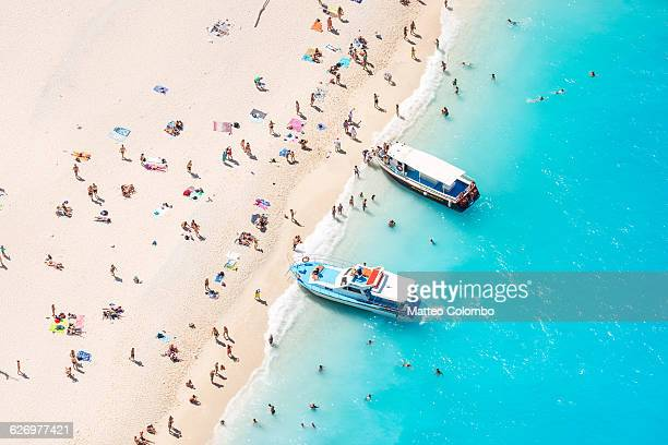Aerial of beach in summer crowded with people