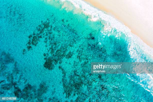 aerial of beautiful lagoon with beach