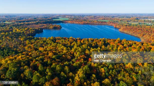 aerial of beautiful lake in autumn - syracuse new york stock pictures, royalty-free photos & images