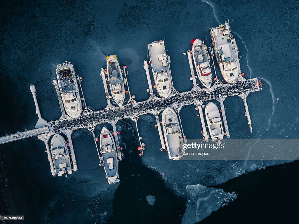 Aerial of boats in frozen harbor, Iceland : Stock Photo
