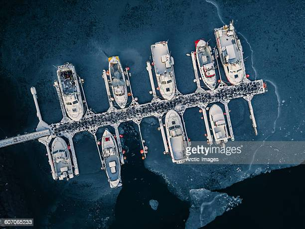 Aerial of boats in frozen harbor, Iceland