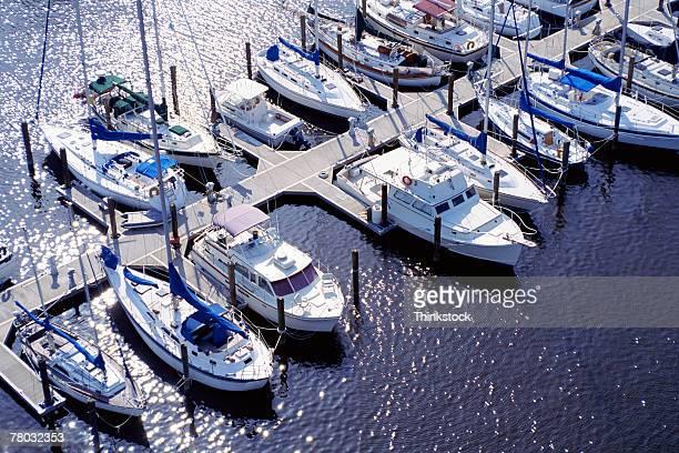 Aerial of boats in marina slips.