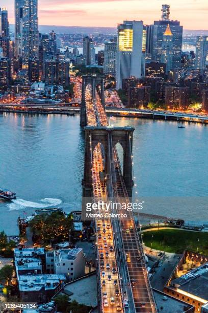 aerial of brooklyn bridge at dusk, new york city, usa - brooklyn new york stock pictures, royalty-free photos & images