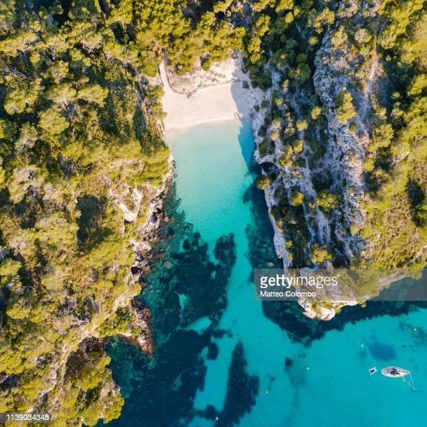 aerial of cala macarelleta beach, menorca - カラマカレラ ストックフォトと画像
