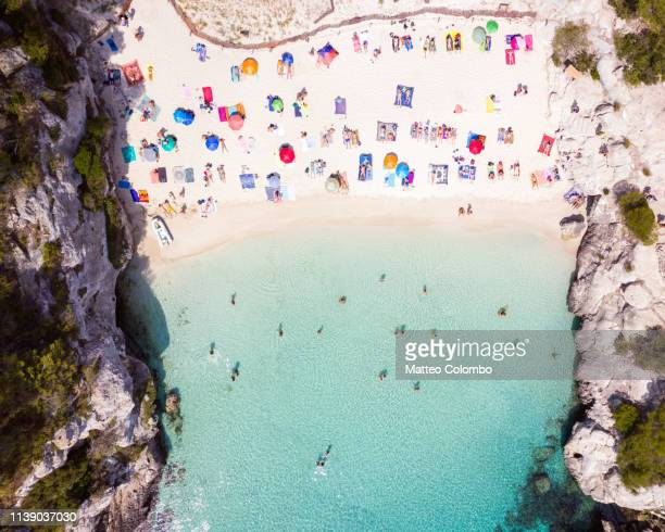 aerial of cala macarelleta beach, menorca - spain stock pictures, royalty-free photos & images