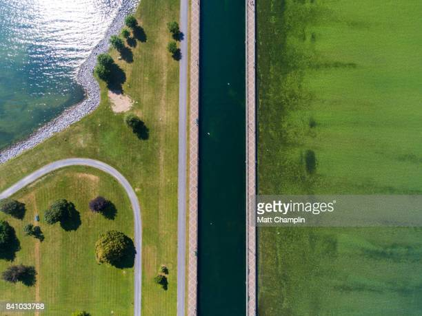 aerial of canal leading to open water - eroded stock pictures, royalty-free photos & images