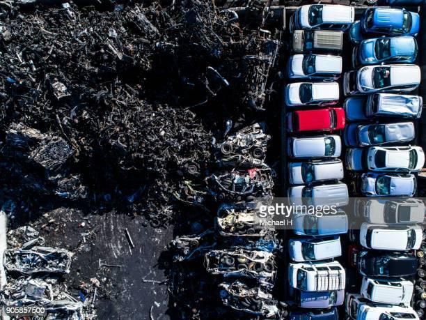 aerial of car scrapyard - junkyard stock photos and pictures