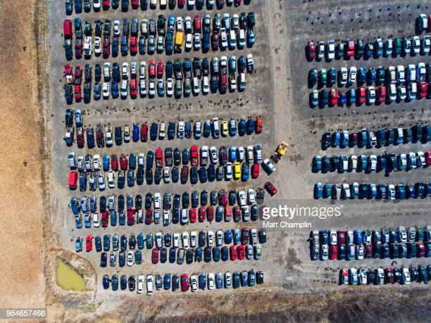 aerial of cars in a scrapyard - junkyard stock photos and pictures