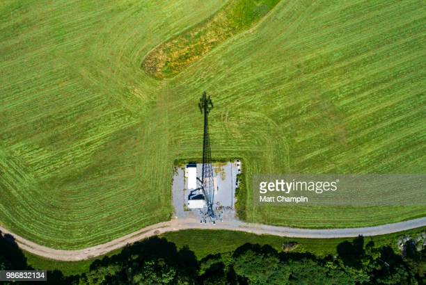 aerial of cell tower and shadow - land vehicle stock pictures, royalty-free photos & images
