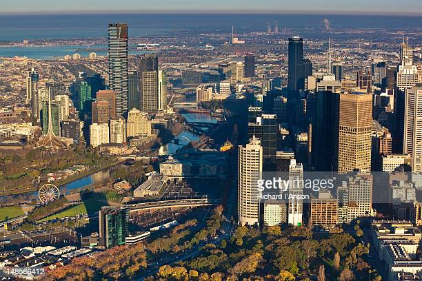 Aerial of central business district, Yarra River, Arts Centre Spire, Eureka Tower and Southbank.