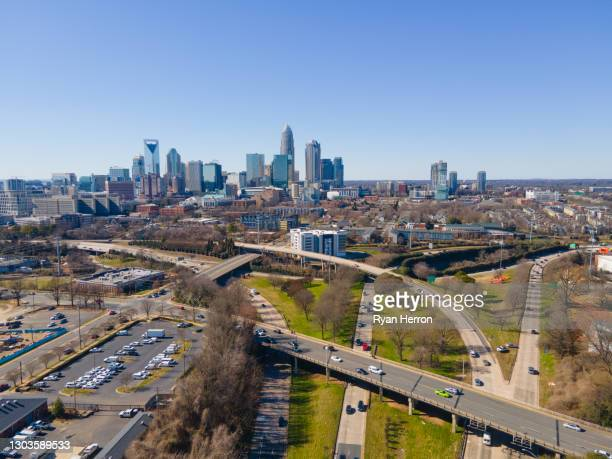 aerial of charlotte, north carolina skyline - charlotte north carolina stock pictures, royalty-free photos & images