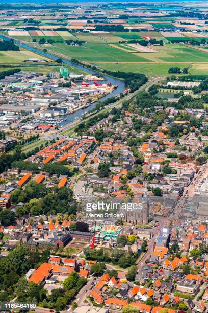 aerial of city centre and surrounding flower fields of schagen - merten snijders stock pictures, royalty-free photos & images